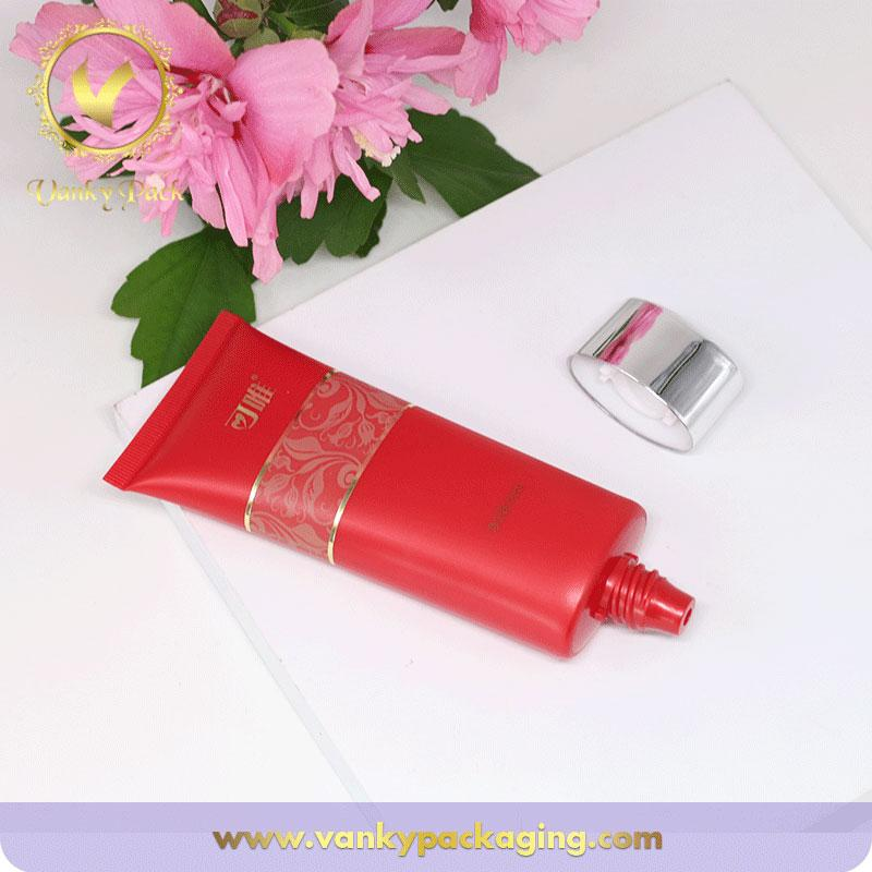Wholesale biodegardable red cosmetic plastic tube for makeup cream