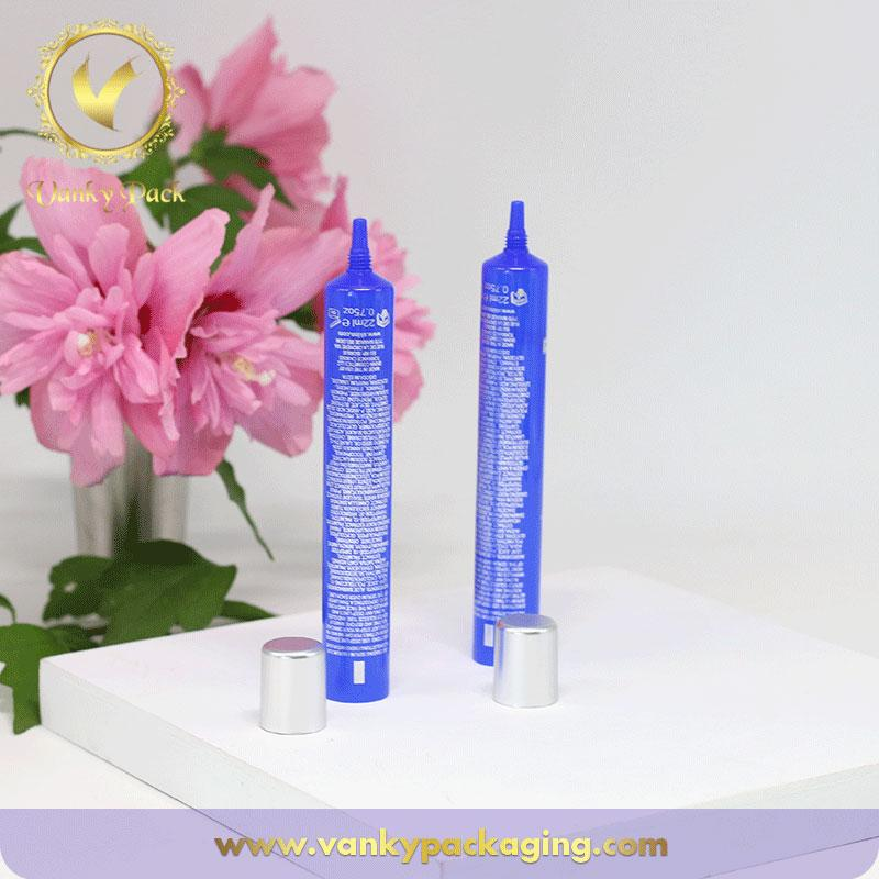 Wholesale blue cosmetic plastic tube packaging with silver hot stamping customized