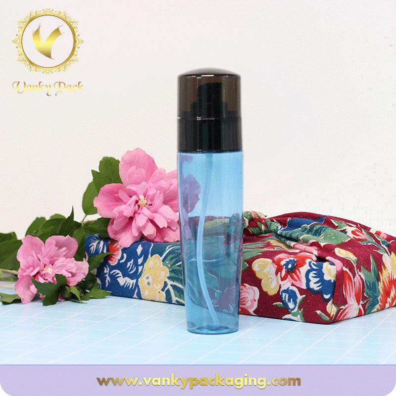 Wholesale blue transparent cosmetic PET plastic bottle with pump spray and black cap
